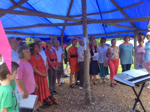 """"""" The Whitstable Bay Singers"""" performing at Stream Walk Community Garden Open Day, June 2014"""